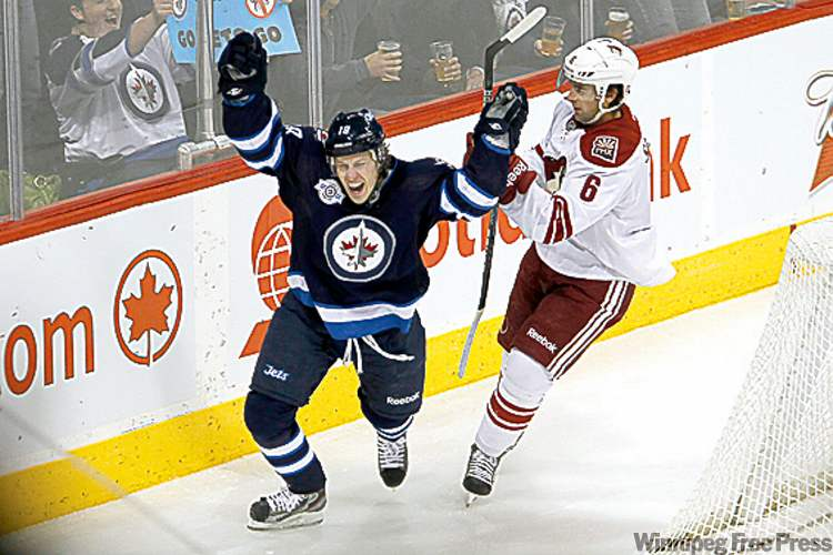 Bryan Little celebrates a goal against the Phoenix Coyotes Dec. 1 in Winnipeg. His scoring touch is something the Jets are missing, but he may not be back until the new year.