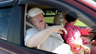 Mike Duffy sits in a vehicle outside a Kensington, P.E.I. dog kennel on Friday July 18, 2014. Duffy is now accused of charging taxpayers for personal travel to funerals and giving money to three people under the guise of a consulting contract. THE CANADIAN PRESS/Andrew Collins