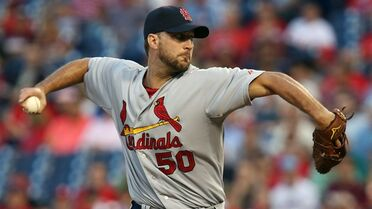 St Louis Cardinals pitcher Adam Wainwright throws in the first inning of a baseball game against the Philadelphia Phillies, Friday, Aug. 22, 2014, in Philadelphia. (AP Photo/Laurence Kesterson)