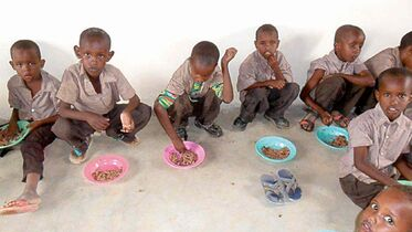 Preschoolers enjoy a lunch of rice and beans at the Humankind  Academy.