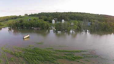 The flooded Assiniboine River at Provincial Road 242 southwest of Portage la Prairie.