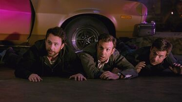 In this image released by Warner Bros. Pictures, Charlie Day, from left, Jason Sudeikis, and Jason Bateman appear in a scene from