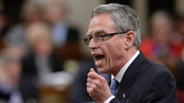 Finance Minister Joe Oliver answers a question in the House of Commons, Tuesday, Sept. 16, 2014 in Ottawa. THE CANADIAN PRESS/Sean Kilpatrick