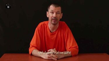 Captive British journalist John Cantlie in an image taken from a video published by the media arm of Islamic State group militants.