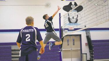 Nov. 26, 2014 - Ben Van Bastelaere, 14, reaches to tip a volleyball over the net at Grant Park High School during practice. For the first time, the Grade 9 boys volleyball team won the city championship, beating Sisler High School in a two set match, 25-21 and 25-21. (DANIELLE DA SILVA/CANSTAR/SOUWESTER).