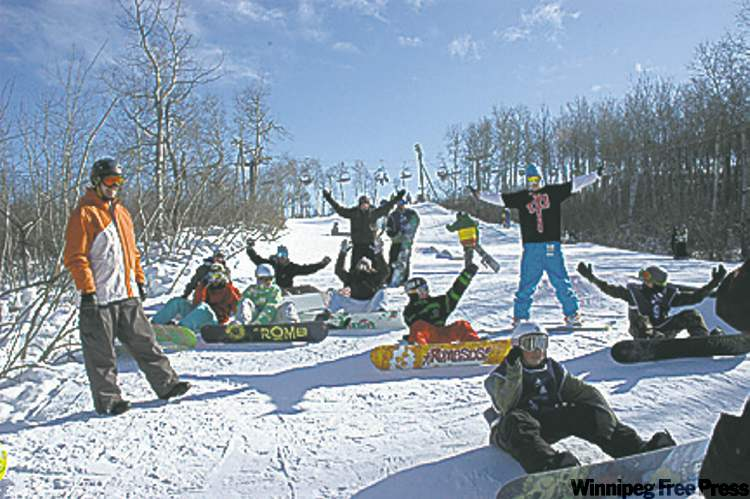 Snowboarders take a brief pause before shredding down one of the resort's runs.