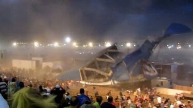 FILE - In this Aug. 13, 2011 file frame grab from video provided by Jessica Silas, a stage roof collapses onto fans awaiting the start of a Sugarland concert at the Indiana State Fair in Indianapolis. Country duo Sugarland, concert promoter Live Nation and 16 other defendants have agreed to pay $39 million to settle claims stemming from the deadly 2011 Indiana State Fair stage collapse, lawyers for the victims and their families announced Friday, Dec. 19, 2014. (AP Photo/Jessica Silas, File)