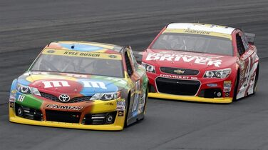 Kyle Busch holds a lead over Kevin Harvick during practice for Sunday's NASCAR Sprint Cup Series auto race at New Hampshire Motor Speedway, Saturday Sept. 20, 2014, in Loudon, N.H. (AP Photo/Jim Cole)