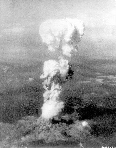 The plume of smoke from a mushroom cloud reaches 20,000 feet after the
