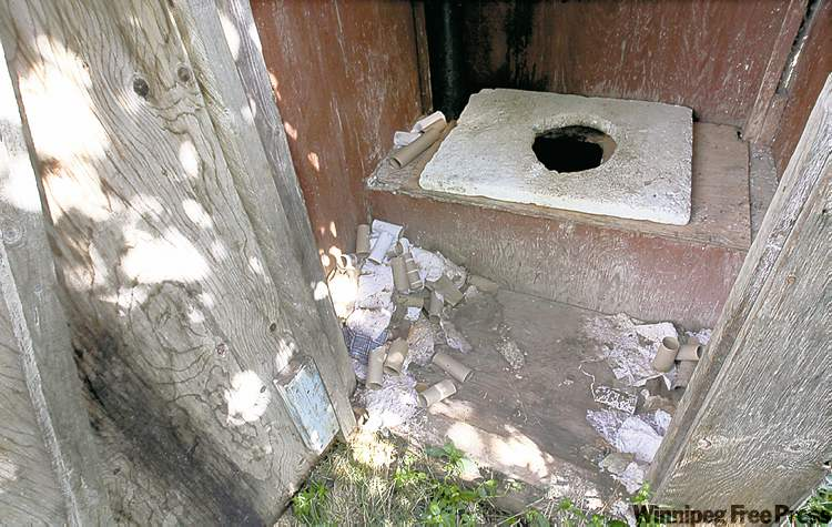 JOE BRYKSA / WINNIPEG FREE PRESS archives; The Canadian Press archives (inset) An outhouse on Wasagamack First Nation is among the substandard living conditions a 2005 pact Paul Martin (inset) negotiated with aboriginal leaders was supposed to correct.