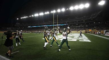 Edmonton Eskimos' #82 A.J. Guyton celebrates his touchdown late in the third quarter against the Winnipeg Blue Bombers Thursday evening at Investors Group Field.