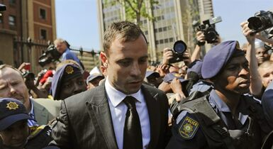 Oscar Pistorius leaves court in Pretoria, South Africa, Friday, Sept. 12, 2014. THE CANADIAN PRESS/AP