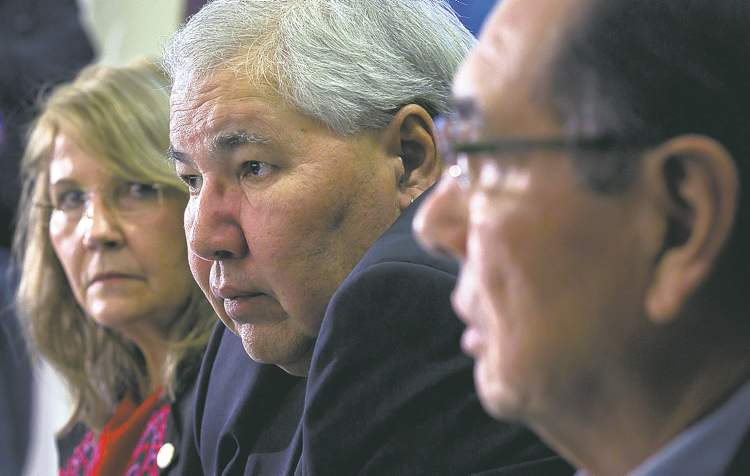 Truth and Reconciliation commissioners (from left) Marie Wilson, Justice Murray Sinclair and Chief Wilton Littlechild release their interim report on residential schools Friday.