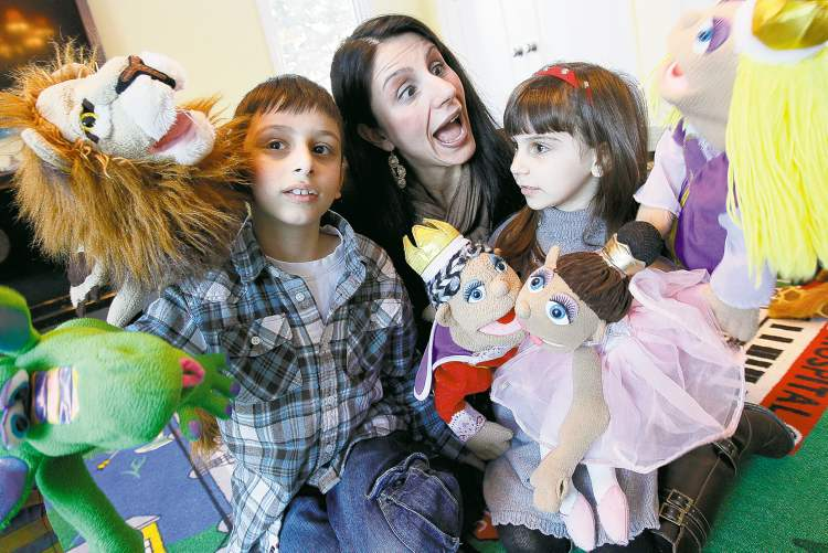 John Woods / Winnipeg Free Press Demetra Hajidiacos, with her children, Peter, 7, and Anna, 5, says her theatre classes for children with autism teach social skills.