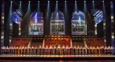 This March 2, 2015 photo provided by MSG Entertainment shows the rehearsal for the New York Spring Spectacular at Radio City Music Hall in N.Y. There's more than 40 Rockettes, 500 gallons of water falling as rain, live dogs, digital projections, a drone kite, 3-D images - funny cardboard glasses provided - aerial dancing, a film montage, a 26-foot tall animatronic puppet of the Statue of Liberty, a full-size taxi, a huge orchestra and bracelets for everyone in the audience that change color in coordination with the action onstage. The show, which opened Thursday, March 26, 2015, at the 6,000-seat Radio City Music Hall, is more than a workout for the dancers - it's a nonstop, messy, cool, goofy, sloppy wet kiss to the city. (AP Photo/MSG Entertainment, Carl Scheffel)