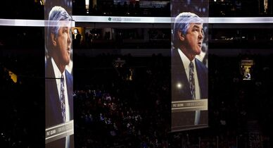Banners showing former Vancouver Canucks player, coach and general manager Pat Quinn are pictured during a tribute to him prior to the first period of NHL action between the Canucks and the New Jersey Devils in Vancouver, B.C., on Tuesday, Nov. 25, 2014. Quinn died Sunday night at the age of 71 after a long illness. THE CANADIAN PRESS/Jonathan Hayward