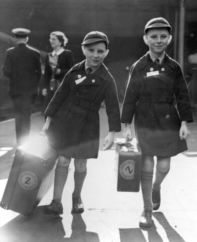 10-year-old twins Brian Thomas Sullivan (left) and Kevin James Sullivan from Islington, London, who carry their luggage to the boat train