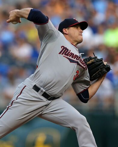 Minnesota Twins starting pitcher Kevin Correia throws in the first inning during a baseball game against the Kansas City Royals Thursday, July 31, 2014, in Kansas City, Mo. (AP Photo/Ed Zurga)