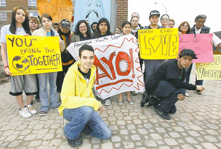 Michael Champagne and youths gather for a bell tower rally at Selkirk Avenue and Powers Street.