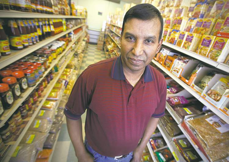 "Nizamuddin Khan, owner of Meghna Grocery: ""I used to know everyone who walked in here. Now I see faces I don't recognize."""