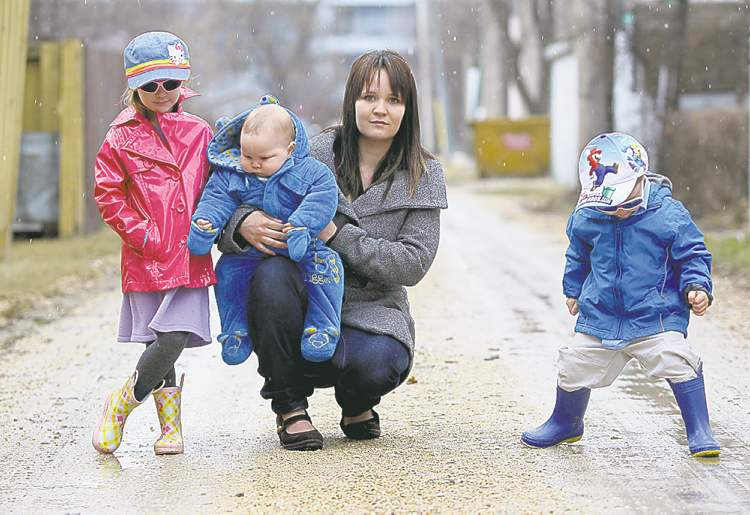 Chantel Miyai with (from left) Emma, 5, Caleb, 7 months, and Kaiden, 2. She says child support belongs to the children.