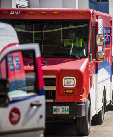 MIKAELA MACKENZIE / WINNIPEG FREE PRESS    Canada Post employees from the Moray Street depot do a drive-by tribute to support frontline workers at the Grace Hospital in Winnipeg on Wednesday, April 22, 2020. Standup.  Winnipeg Free Press 2020