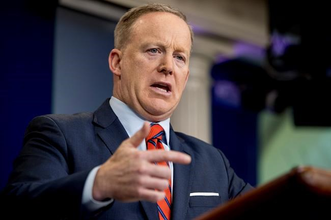 Calls for Trump's press secretary to resign after Hitler gaffe