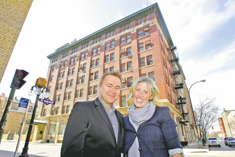 Winnipeg developer  Mark Buleziuk, with wife Shelley, says he plans to convert the seven-storey Maltese Cross Building into furnished rental offices.