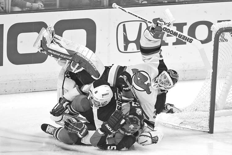 J Pat Carter / The Associated PressFlorida Panthers� Marcel Goc (bottom) and New Jersey Devils� Andy Greene collide and go into a skid, taking the feet from under Devils goalie Martin Brodeur in a second-period mishap.