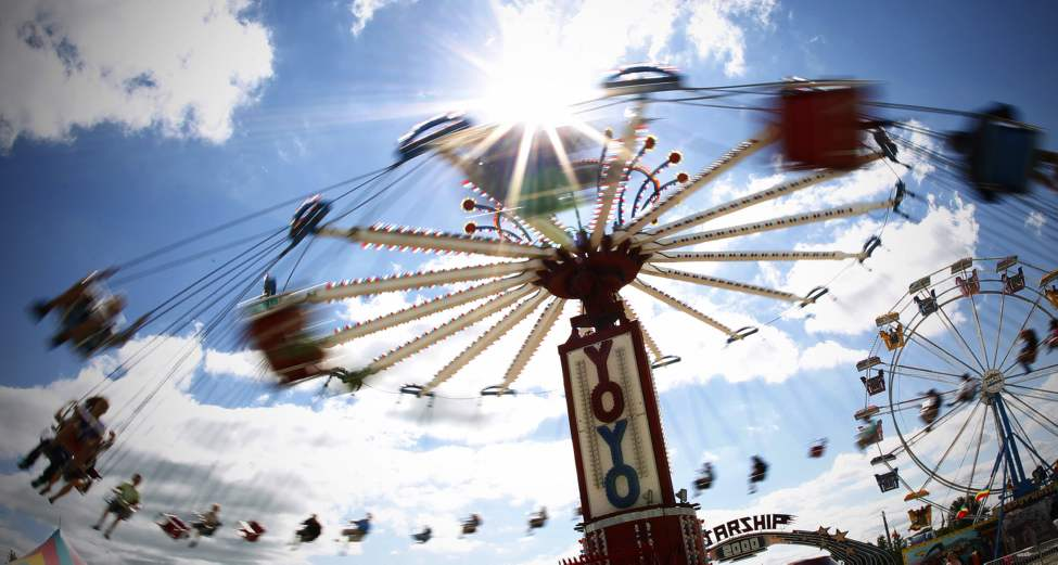 People enjoy a ride on the YoYo at the Morris Stampede in Morris. July 22, 2011 (John Woods/Winnipeg Free Press)