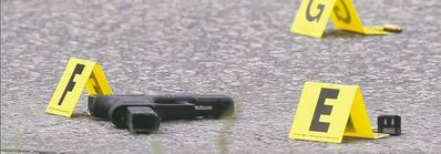 Bullet and handgun on Stafford Street at Hector Avenue near the Salisbury House on Pembina Highway, where two men were shot Sept. 27. One man died from his injuries.