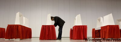 A delegate marks his ballot for leader and party executives at the Liberal Leadership Convention Saturday in Vancouver.