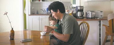 Guillermo Vodniza feeds his son, Pablo.