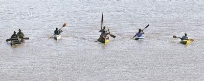 In a custom-built six-metre canoe (centre) of Don Starkell's, son Dana Starkell, his wife, Stacey, their son, David, and Dana's brother, Jeff Starkell, paddle during the 2nd Annual Paddle to the Park Sunday.