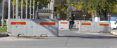 In the interim, the city plans to place wide concrete dividers known as Jersey barriers, like these.