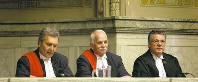 Justice Vic Toews, sitting between Court of Queen's Bench Chief Justice Glenn Joyal (left) and Appeal Court Chief Justice Richard Chartier, at his swearing-in ceremony Friday. Leaving the familiar world of politics, at which he excelled, takes guts.