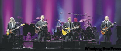 Timothy Schmit (from left, top photo), Don Henley, Glenn Frey and Joe Walsh perform last weekend.