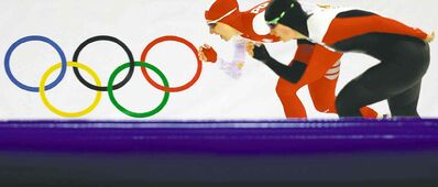 Canada's Brittany Schussler (front) and Luiza Zlotkowska of Poland compete in the women's 3,000-metre speedskating race on Sunday.