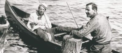 Tom Thomson (right in canoe) is the subject of a new documentary.