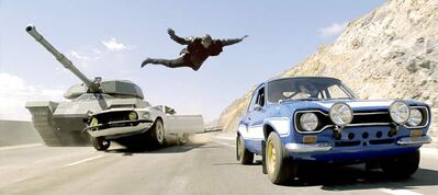 Universal PicturesTyrese Gibson leaps onto the roof of a car in Fast & Furious 6.