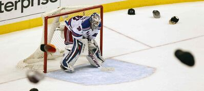New York Rangers goalie Henrik Lundqvist hangs his head as the hats fly.