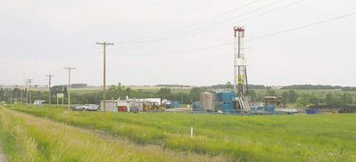 The presence of a drill, tanks and trailers can indicate a frack is underway in the oilfield south of Cromer. Meanwhile, the area's roads draw bitter complaints.