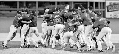 Fernando Salazar / Wichita Eagle Archives (ABOVE), JOHN WOODS / WINNIPEG FREE PRESS ARCHIVES (ABOVE Far LEFT),  Gerry Kahrmann / Postmedia News ARCHIVES (Above LEFT)The Goldeyes celebrate after defeating the Wichita Wingnuts to claim the American Association championship. Above left: Desiree Scott, Andrew Harris.