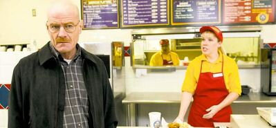 Bryan Cranston, above, as Walter White at the fictional restaurant Los Pollos Hermanos. A burrito joint that serves as the location has become a tourist attraction. Debbie Ball, right, displays her line of �meth candy� made from sugar rock candy.