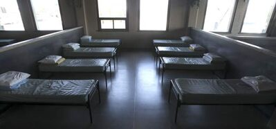 Beds on the second floor of Siloam Mission await guests for the night.