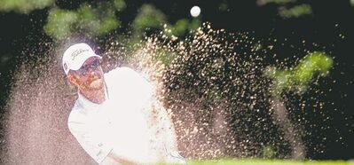 Michael Mezei from Lethbridge blasts from a bunker at Players Classic qualifying on Monday at Glendale. Mezei made the grade with a one-over 73.