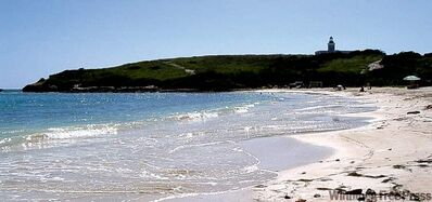 Playa Sucia, a beach in Cabo Rojo, Puerto Rico, with Los Morrillos lighthouse in the distance.