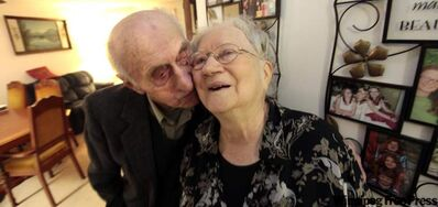 Ed Barkman gives wife of 70 years Tina a kiss on the cheek Tuesday in their Steinbach home. They say marriage is a commitment and divorce was not an option.