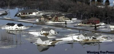 2009: Fargo-area homes are surrounded by water from the Red River.