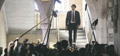 Justin Trudeau makes his way to his first question period as Liberal party leader Monday. Trudeau won the leadership contest Sunday in Ottawa.